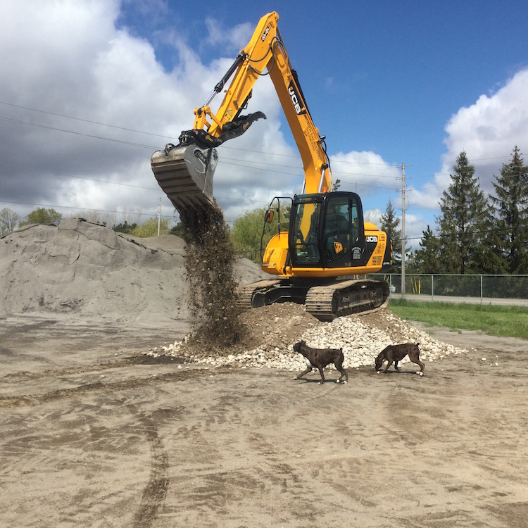 Backhoe dumping with hounds